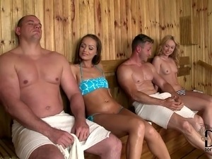 Beautiful girls seduce handsome guy in sauna