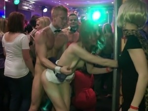 Impassioned pornstars enjoying a steamy groupsex party in a club