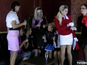 Pissing pack of lesbians have fun touching and kissing in a steamy orgy scene
