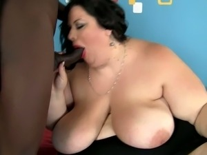 Very fat brunette chick gives a titjob and gets fucked by Black dude