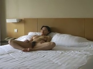 Cute Chinese wife poses for me nude in the bedroom