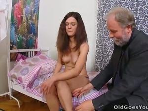 This nasty brunette lets her old perverted professor eat her snatch