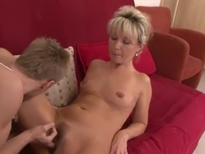 Beautiful blonde MILF takes a load from a young stud