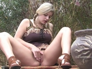 Pigtailed beauty toys her hot pussy at a picnic