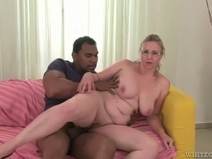 Chubby white blond head takes big fat black cock in her soaking meaty cunt