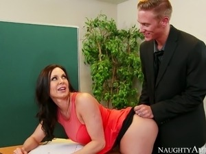 Nasty secretary with big boobs Kendra Lust fucked on the table by Richie Black