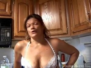Trashy old spunker in sexy lingerie fucks her juicy pussy
