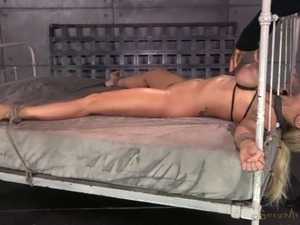 Bondage slave giving black giant cock blowjob in BDSM porn
