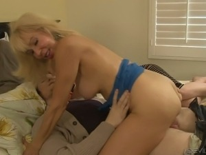 Kinky blond cougar Erica Lauren fucks with young stud when his bitch sleeps...