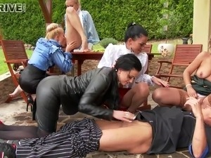 Kinky sluts blow a dude's cock in an orgy & piss all over him