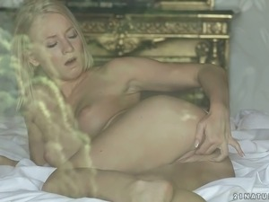 Delicious blonde babe finger fucks her smooth pussy and moans with pleasure