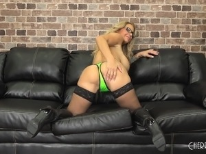 Busty blonde hotties sits naked on the couch and sucks a wanker