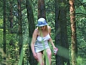 Lovely and cute Russian busty babe pisses in the forest