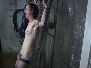 Skinny slave with small tits inserted in polythene in BDSM porn