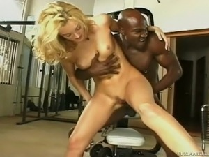 Beefcake black trainer fucks slim blond slut Monica Mayhem in the gym