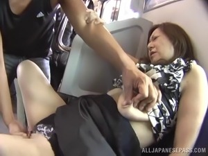 Mature Japanese woman being fondled on a train ride