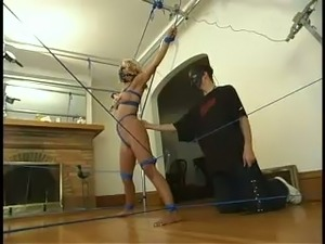 Amazing blondie is under an amazing bondage