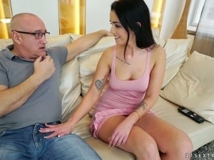 Mature white man on the couch with young and lascivious brunette