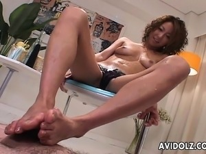 Oiled up brunette slut foot fucks a hot cock