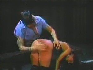 Hot slut enjoys getting her ass spanked by a retro police office