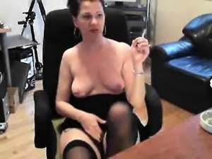 Hot Webcam Brunette in Stockings Masturbates with a Dildo