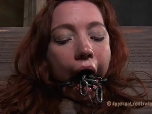 Redhead called Maggie is getting tortured by her aggressive captors