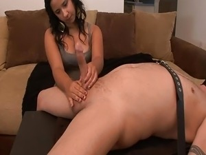 spanish girl evaluates cock during FemDom handjob
