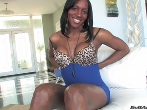Fabulous ebony shemale with a nice ass milking his cock close up