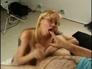Lovely blonde lady in glasses shows off tits while giving head