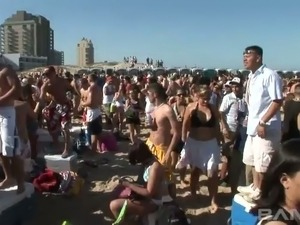 Frivolous tanned girls are dancing and sucking each others nipples on the beach