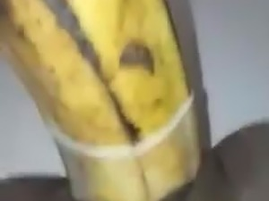 Ebony girl masturbates with a banana