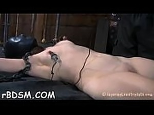 Cutie gets her neck restrained and knockers clamped