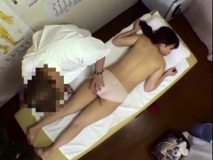 Attractive Japanese babe gets massaged and fucked good