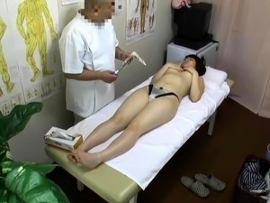Perky breasted Japanese cutie gets fucked on the massage bed
