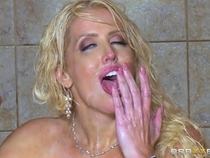 Milf showers in a garter belt and fucks a guy in there