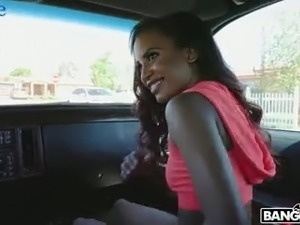 Long haired ebony sexpot Demi Sutra provides her white BF with BJ in his car