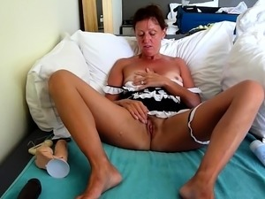 Sensual mature lady in uniform fucks herself with sex toys