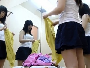 Pretty Japanese girl exposes her body in the changing room