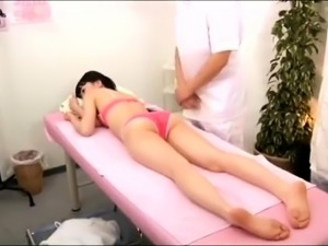 Sexy slim Japanese babe gets massaged and fucked by two guys