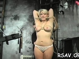Breasty playgirl gets nipple-tortured in bdsm style scene
