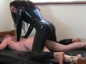 Latex woman shows him the correct way