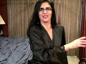 American milf Theresa Soza playing on a bed