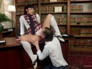 Dressed like a naughty coed chick Mia Li gets her Asian pussy licked