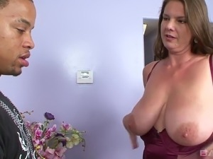 Tattooed black stud fucks meaty pussy of giant breasted whore Carrie Moon