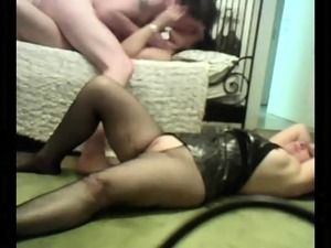 Mature British lady in stockings in threesome