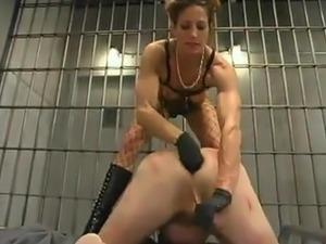 Bitch Kym Wilde Torturing a Masked Guy Behind Bars in Femdom