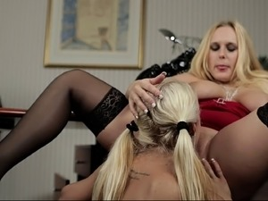 Beautiful lesbian blonde with pigtails smashing the other's anal with massive...